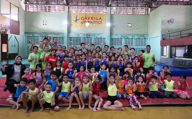 President Watanabe with young Indonesian at Gavrila Gymnastics club in Jakarta