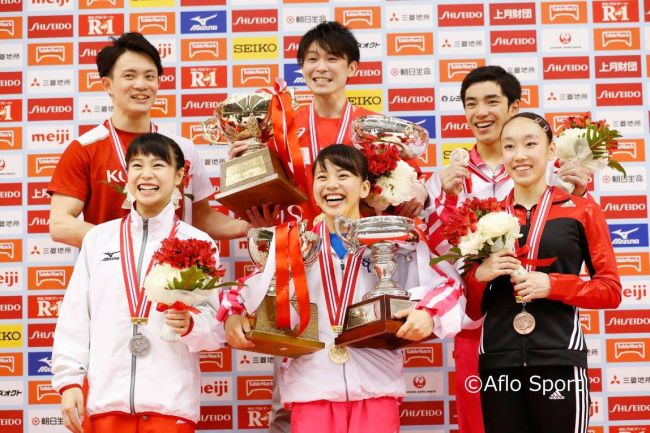 Kohei Uchimura with medalwinners at the Japanese National Championships in April, including men's silver medallist Yusuke Tanaka and bronze medallist Kenzo Shirai, and women's champion Mai Murakami, flanked by runner up Aiko Sugihara and Nagi Kajita. Photos courtesy Aflo Sport and the Japan Gymnastics Association.